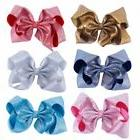 7 glitter hair bows with clips