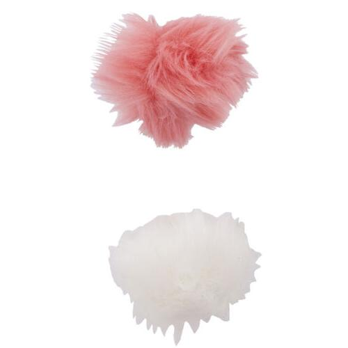 pink and white fabric pom pom hair